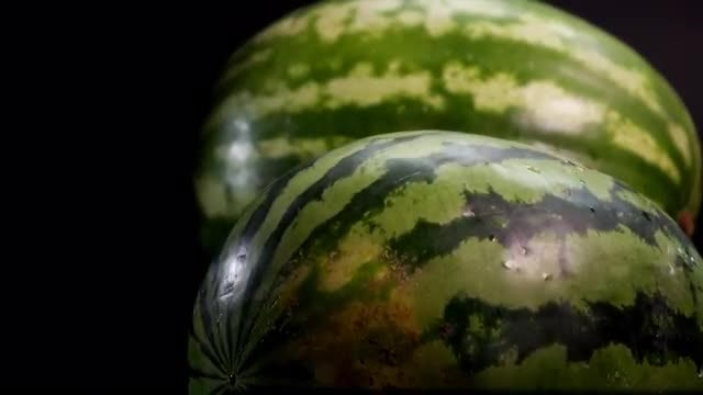 Two Fresh Watermelons Rolling: Stock Video