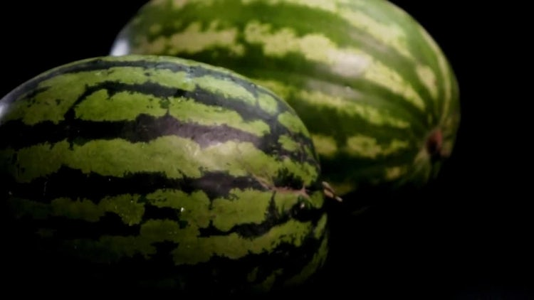 Two Fresh Tasty Watermelons Rolling: Stock Video