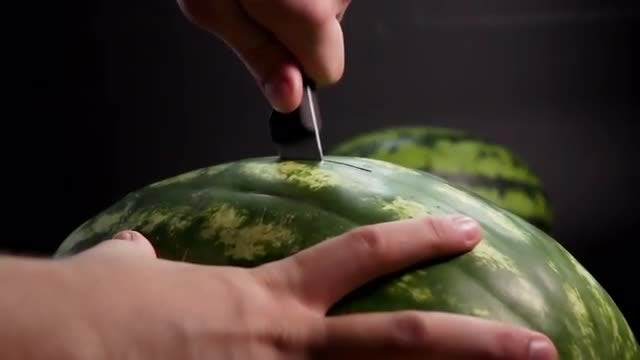 Man Cutting Huge Watermelons: Stock Video