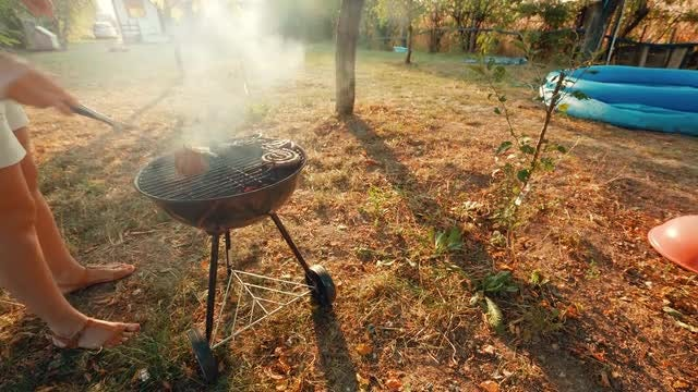 Barbecuing Outdoors In the Yard: Stock Video