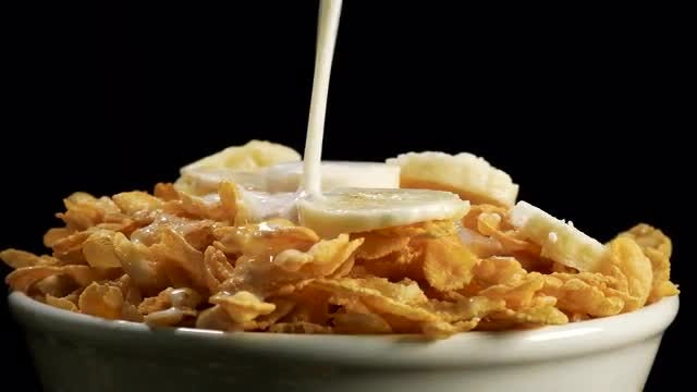 Adding Milk To Cornflakes Cereals: Stock Video