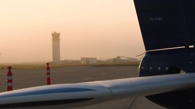 Airplane And Airport Control Tower: Stock Video