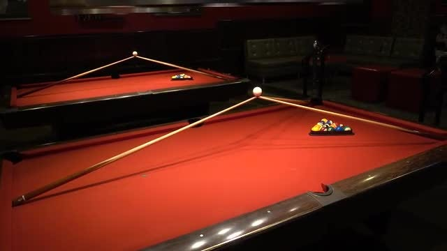 Billiard Tables With Cue Sticks: Stock Video