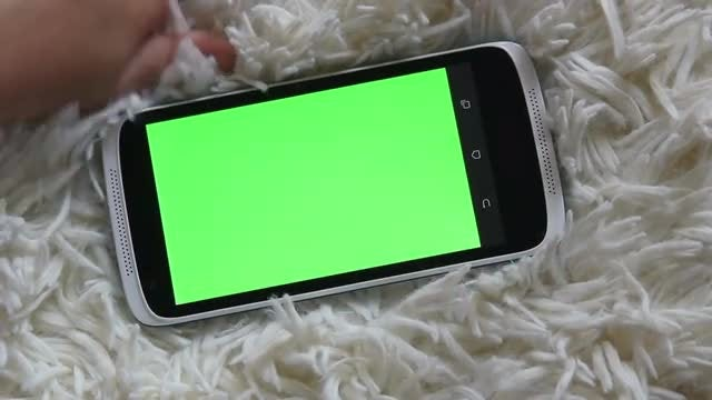 Child Tapping On A Smartphone: Stock Video