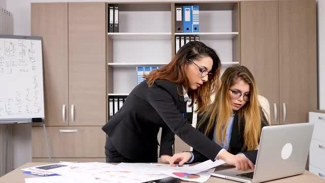 Two Businesswomen Working In Office: Stock Video