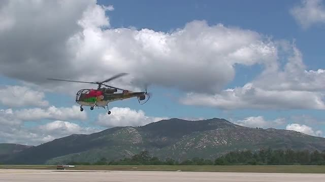 Colorful Helicopters Flying Slowly: Stock Video