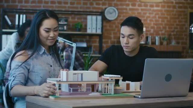 Young Architects Creating Futuristic House: Stock Video