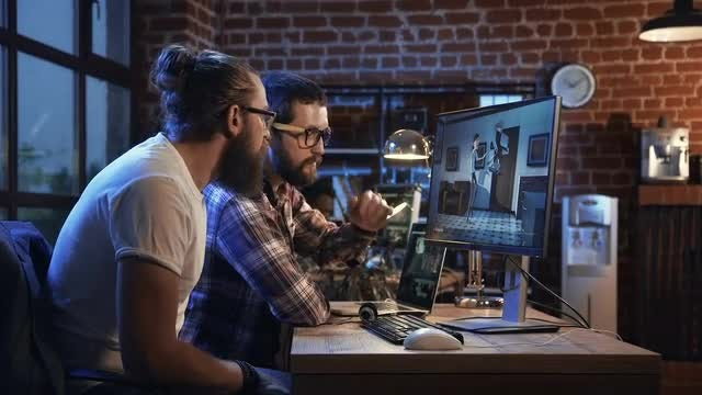 Men Animating On Computer: Stock Video