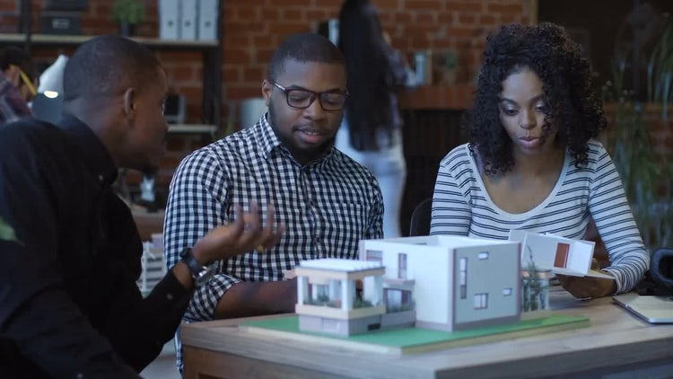 Young Architects Discussing Futuristic House: Stock Video