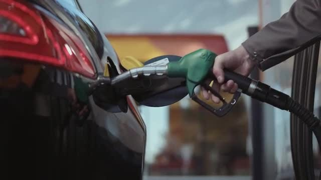 Fuel Poured Into Car Tank: Stock Video