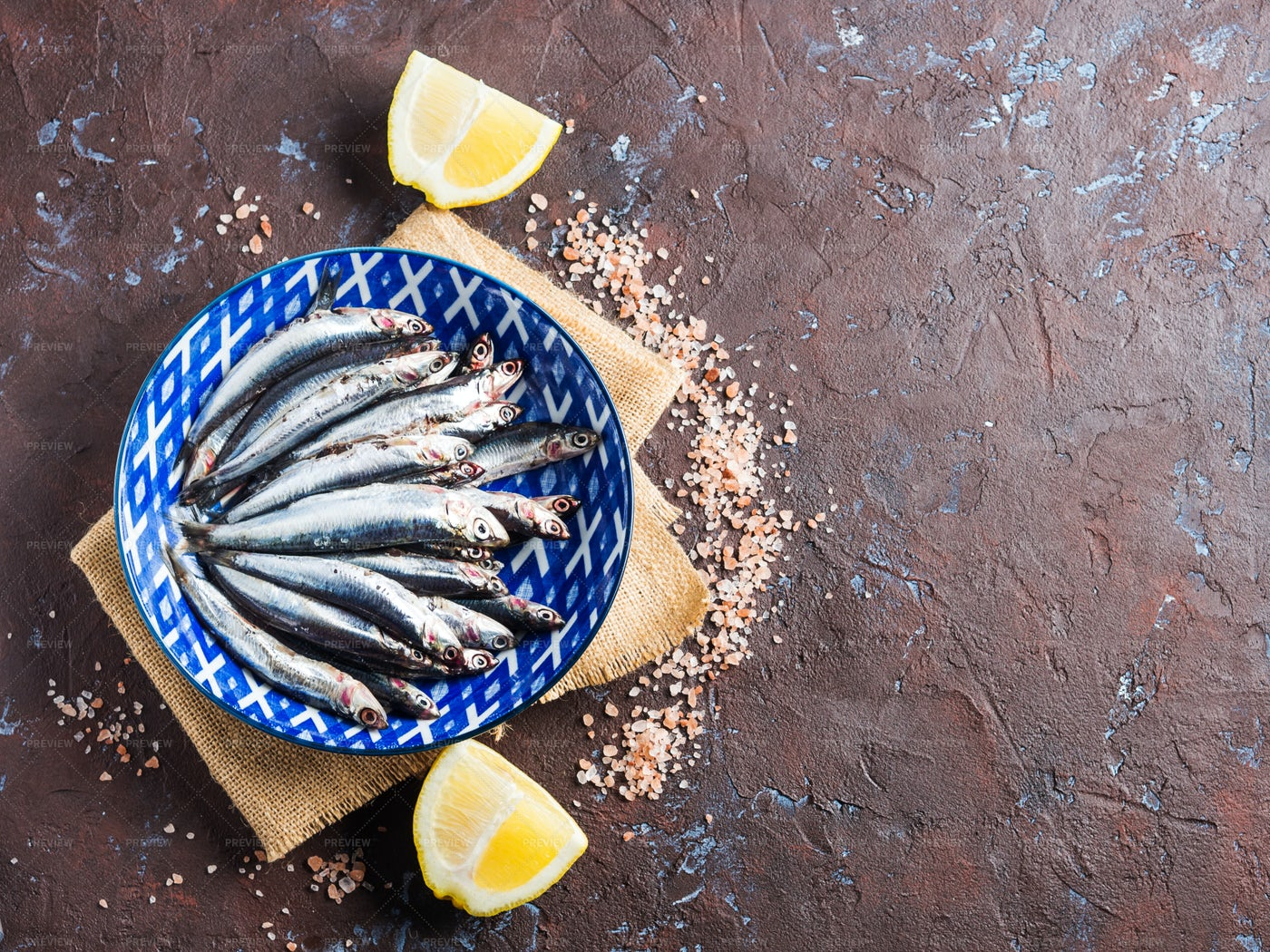 Raw Fishes In Blue Plate: Stock Photos