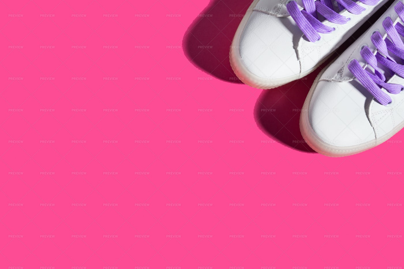 Pink Background With Sneakers: Stock Photos