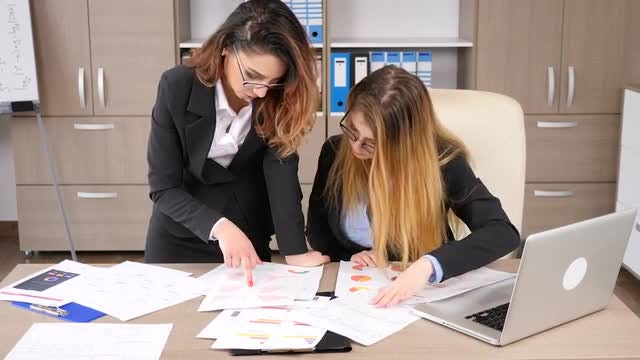 Two Businesswomen Collaborating At Work: Stock Video