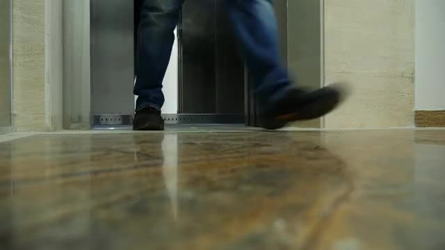 Man Walking Out Of Elevator: Stock Video