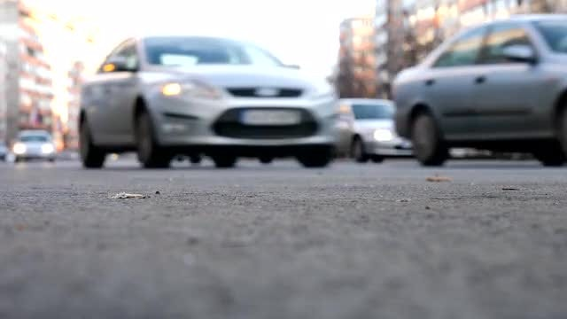 Blurred Cars Driving In City: Stock Video
