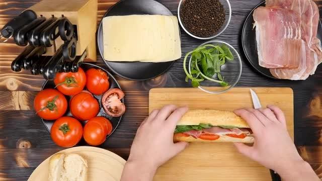 Chef Making Sandwich In Kitchen: Stock Video