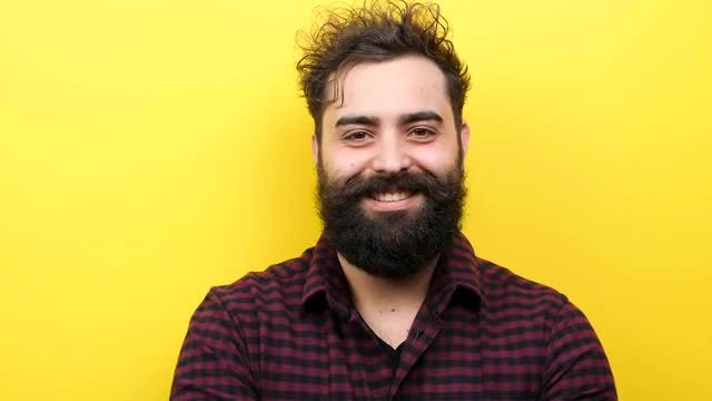 Smiling Bearded Man - Yellow Background: Stock Video