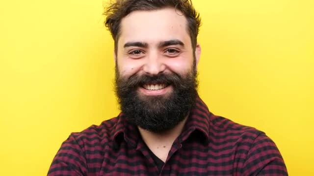 Bearded Hipster Winking At Camera: Stock Video