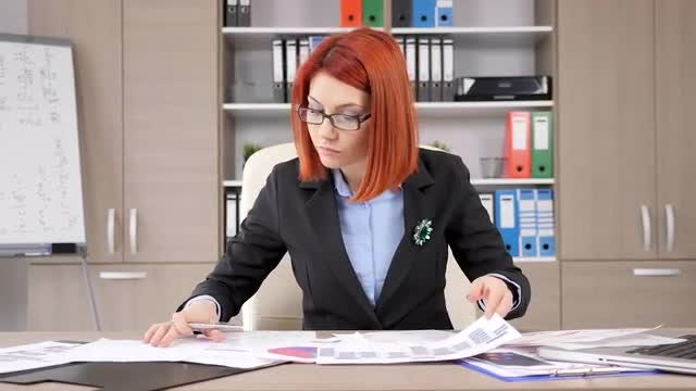 Businesswoman Working In The Office: Stock Video