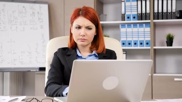 Businesswoman Typing On Her Laptop: Stock Video