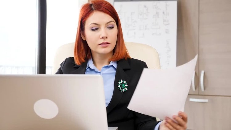 Businesswoman Typing On A Laptop: Stock Video