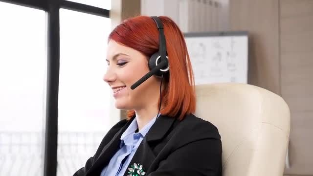 Customer Support Employee With Headset: Stock Video