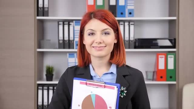 Businesswoman Holding Business Report: Stock Video