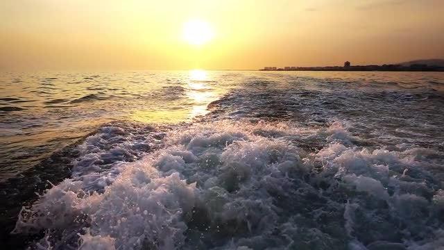 Ocean Waves Trailing Behind Boat : Stock Video