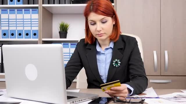 Woman Shopping Online: Stock Video