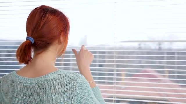 Woman Looks Outside Window : Stock Video
