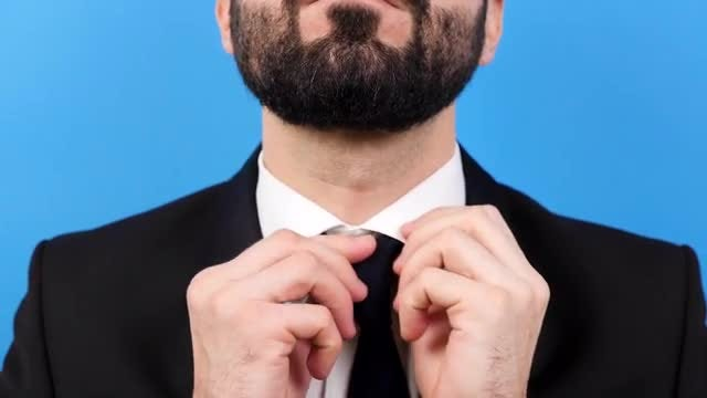 Close-up Of Businessman Tying Tie: Stock Video