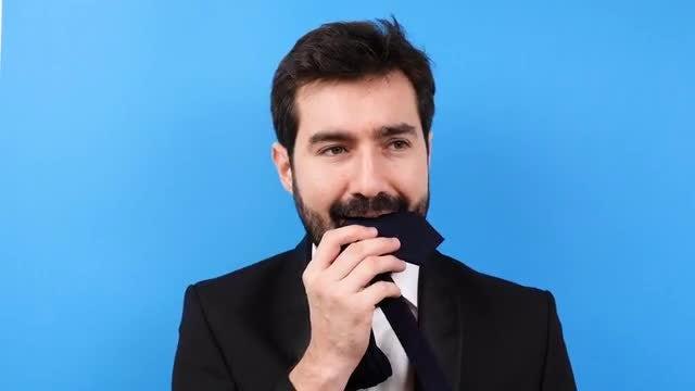 Stressed Businessman Bites His Tie: Stock Video