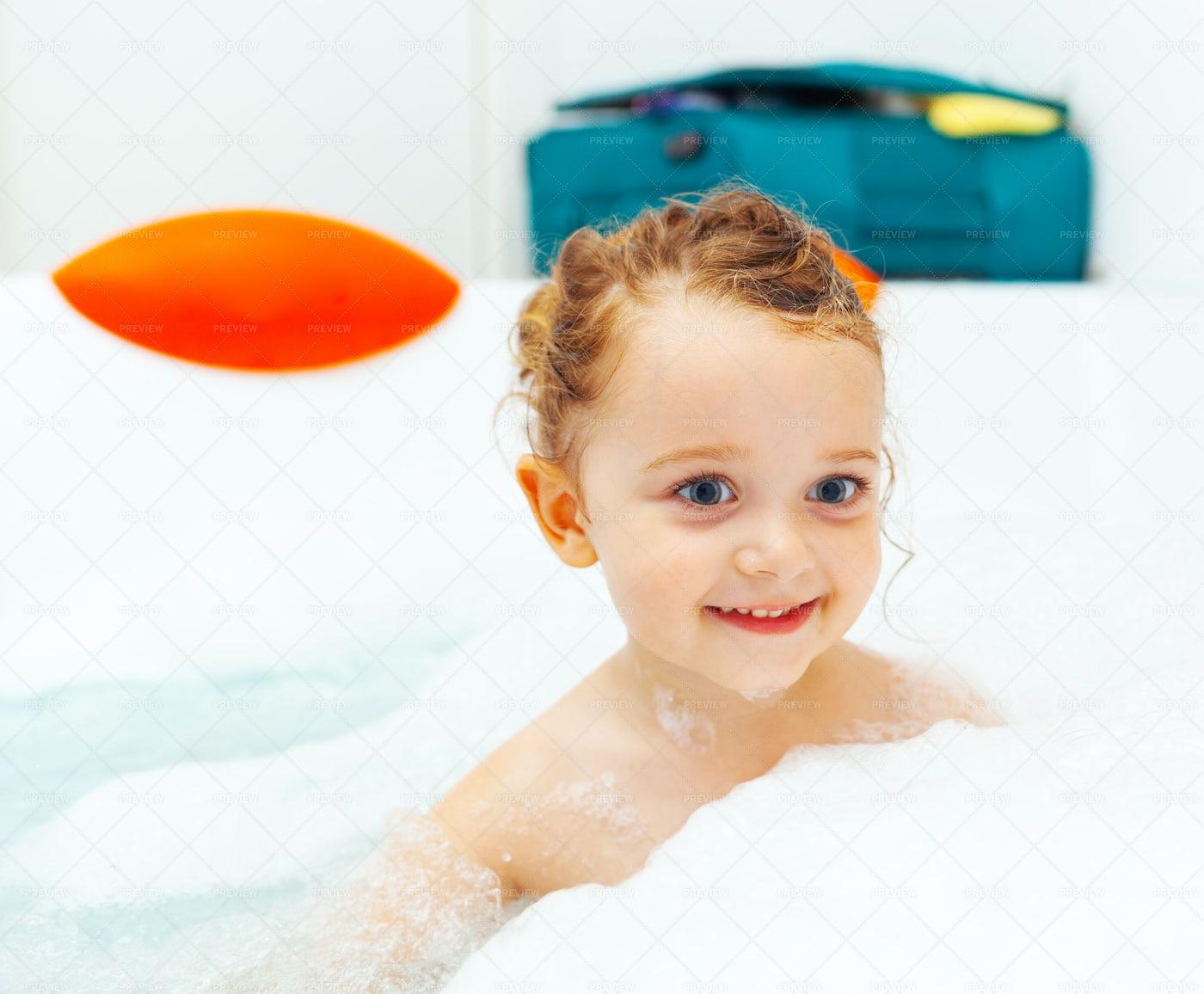 Little Girl Takes A Bath: Stock Photos