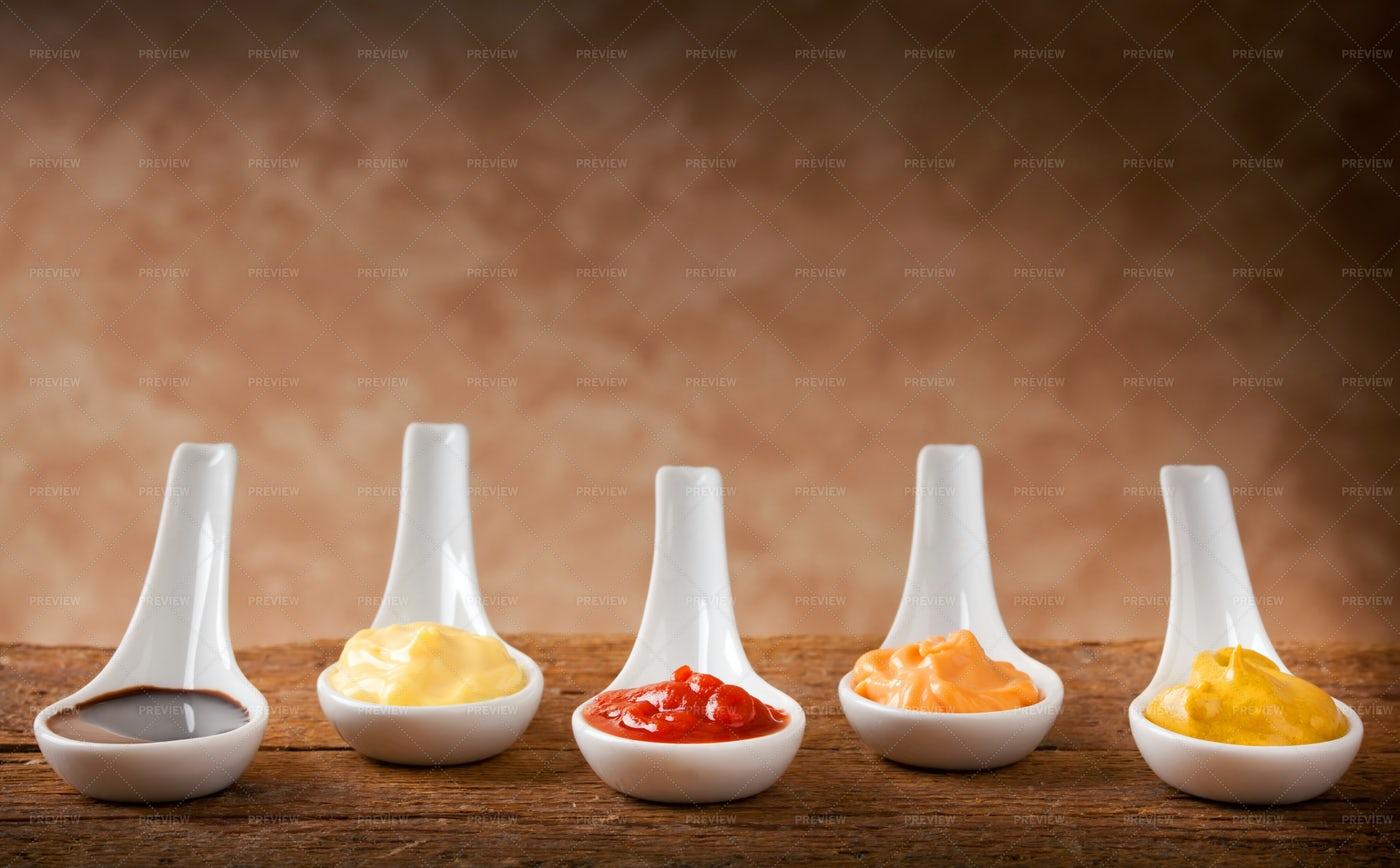 Sauces In Ceramic Spoons: Stock Photos
