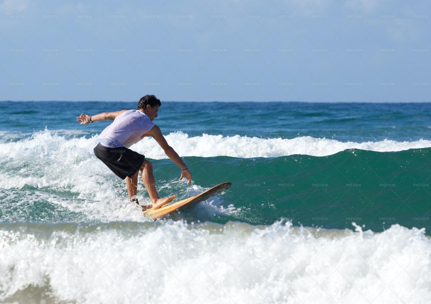 Surfer Riding A Wave: Stock Photos