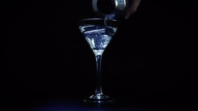 Martini Drink Poured Into Glass: Stock Video