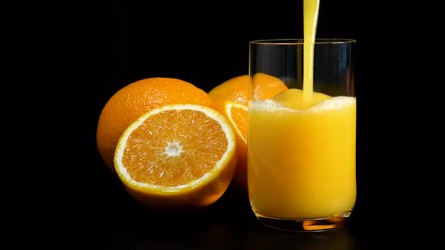 Pouring Orange Juice Into Glass: Stock Video