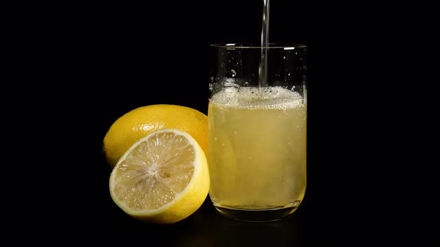 Lemon Juice Poured Into Glass: Stock Video