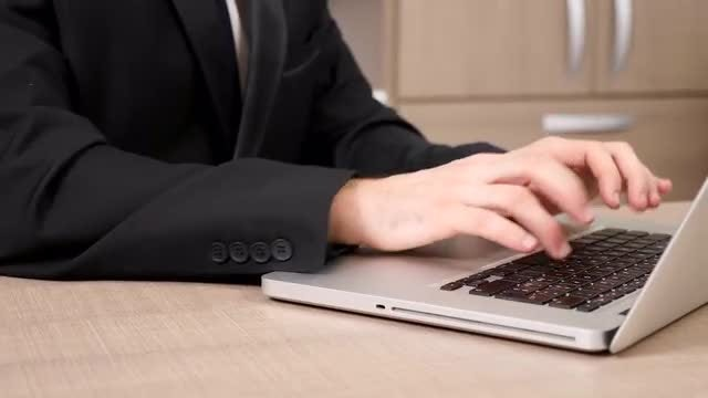 Businessman Typing On A Laptop: Stock Video