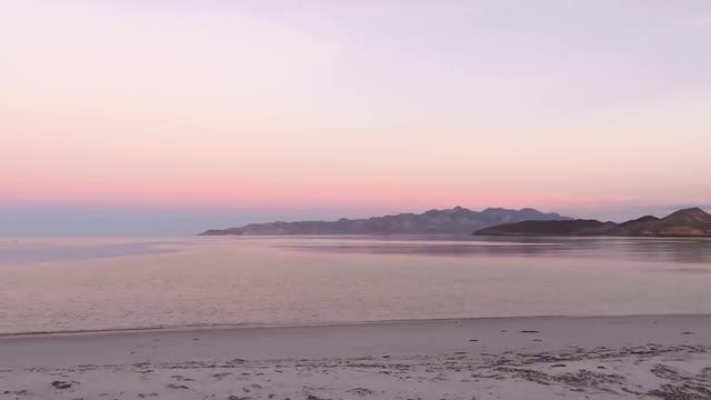 Pan of Beach During Sunrise: Stock Video