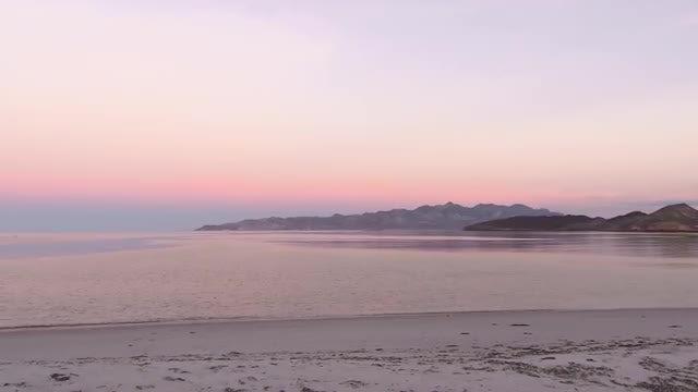 Pan of Beach During Sunrise: Stock Video
