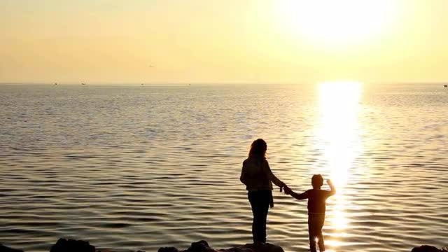 Mum And Son Throwing Stones : Stock Video