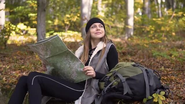 Girl With Map In forest: Stock Video