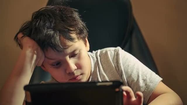 Boy Using Tablet PC: Stock Video