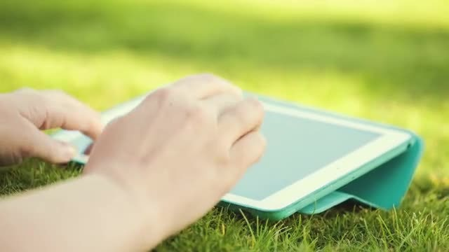 Woman Using Touchpad Outdoors: Stock Video