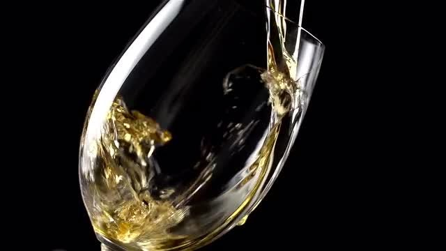 Pouring Wine Into A Glass: Stock Video