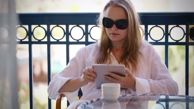Woman Using Tablet On Balcony: Stock Video