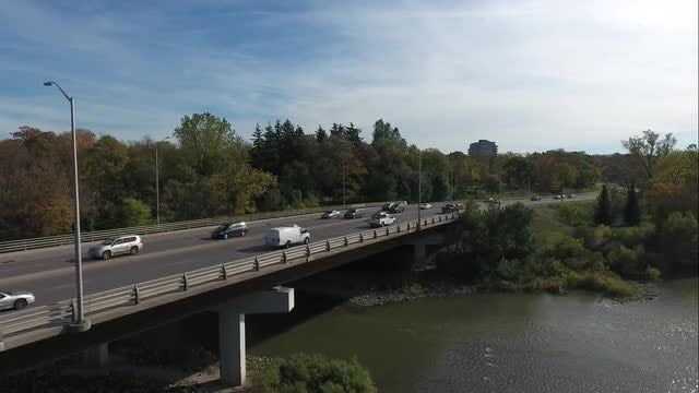 Cars Driving By On Bridge Aerial: Stock Video