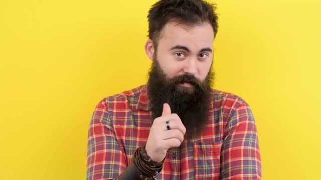 Bearded Hipster Against Yellow Background: Stock Video