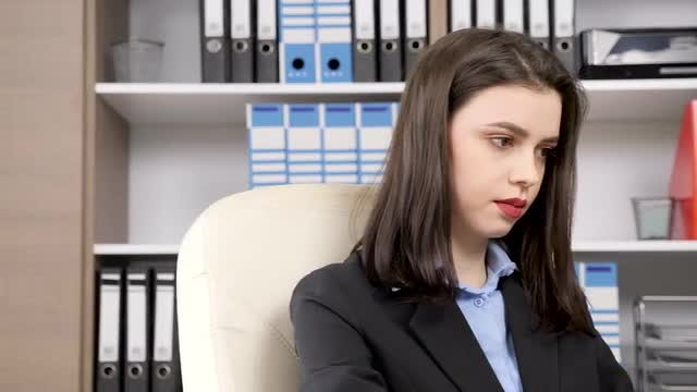 Young Businesswoman Working In Office: Stock Video